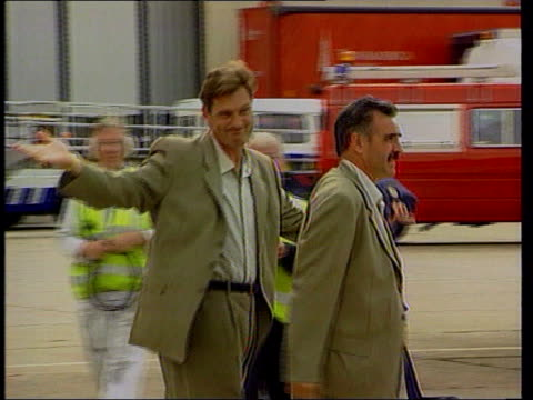 glenn hoddle sacked following controversial comments heathrow airport glenn hoddle along tarmac gesticulating and waving - glenn hoddle stock videos & royalty-free footage