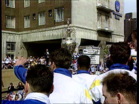 glenn hoddle sacked following controversial comments; leeds: howard wilkinson and leeds united players atop bus parading the league championship... - trophy stock videos & royalty-free footage