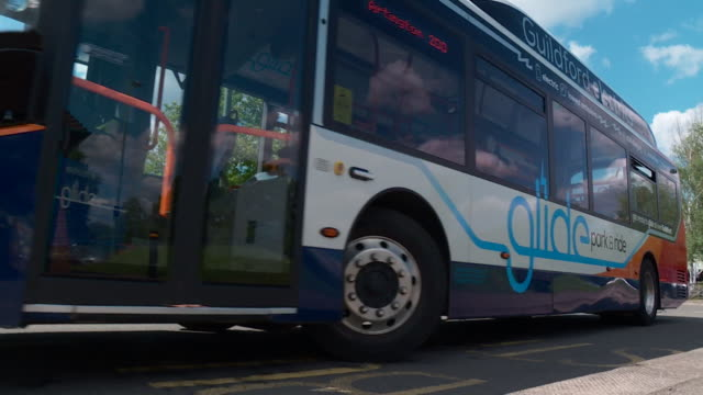 glide an electric bus park and ride service in guildford - mode of transport stock videos & royalty-free footage