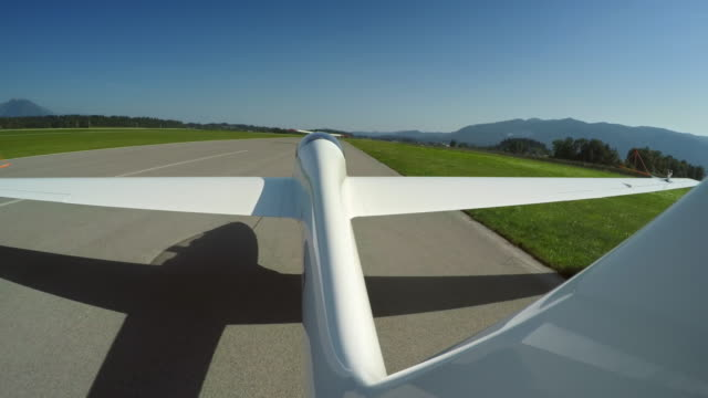 ld glider being towed into the air in sunshine - gliding stock videos and b-roll footage