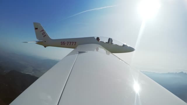 ld glider dropping off the towing rope high in the air in sunshine - glider stock videos & royalty-free footage