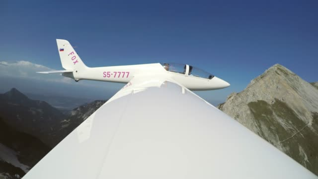 ld glider flying in the sky on a sunny day - glider stock videos & royalty-free footage