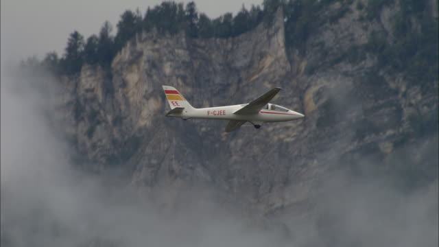 aerial ws glider flying over mountains and clouds / rhone-alpes, france - rhone alpes stock videos & royalty-free footage