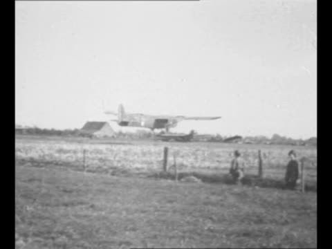 stockvideo's en b-roll-footage met glider lands near nijmegen the netherlands bringing allied airborne reserves during world war ii / glider approaches as it lands wind forces tail of... - zweefvliegtuig