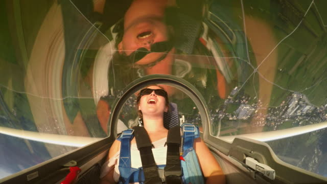 ld glider looping and young female passenger is having fun in the sunny sky - glider stock videos & royalty-free footage