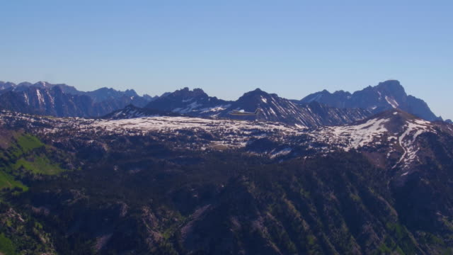 Glider rising above the Teton Mountains