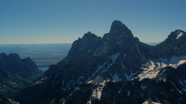 Glider soaring in front of Grand Tetons