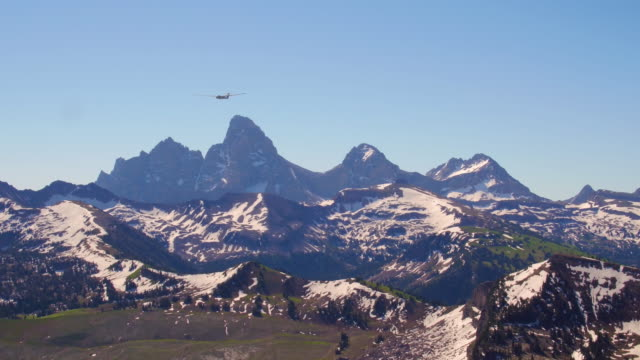 a glider soaring in front of the grand tetons - grand teton video stock e b–roll
