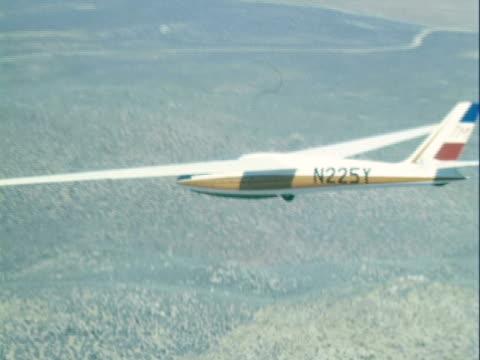 AERIAL Glider soaring over Nevada landscape / Reno, United States