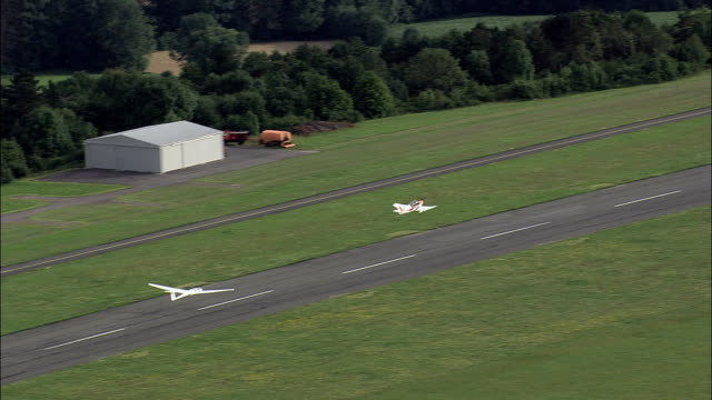 a glider takes off from bayreuth airport  - aerial view - bavaria,  upper franconia,  landkreis bayreuth helicopter filming,  aerial video,  cineflex,  establishing shot,  germany - glider stock videos and b-roll footage