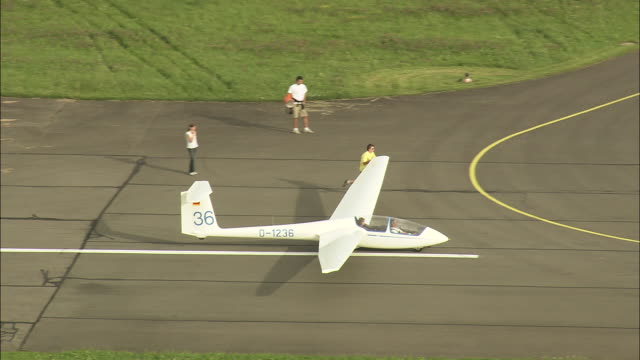 a glider takes off from bayreuth airport - gliding stock videos and b-roll footage