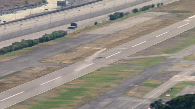 stockvideo's en b-roll-footage met 2010 aerial gliders flying over the runway and ascending into the sky / santiago de chile, gran santiago, chile - start en landingsbaan