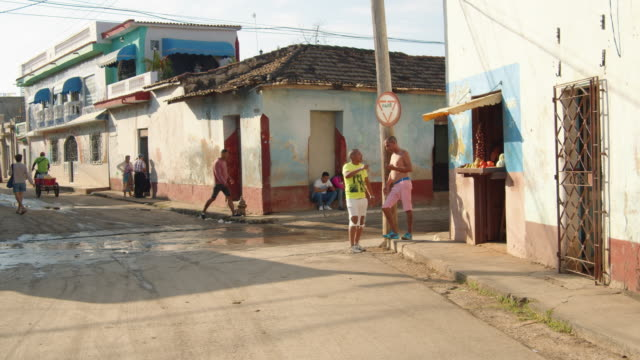 a glimpse of street life in trinidad, cuba - corner stock videos & royalty-free footage