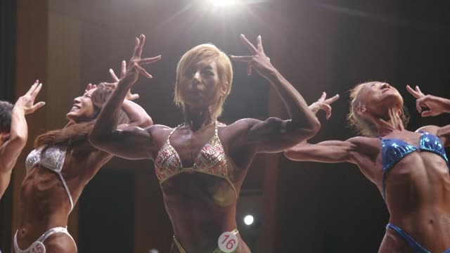 glistening with sweat satoko yamanouchi's biceps ripple and the veins in her neck throb as if about to pop as she strikes a fearsome pose at a... - body building stock videos & royalty-free footage