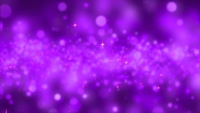vídeos y material grabado en eventos de stock de brillo fondo lazo - fondo púrpura