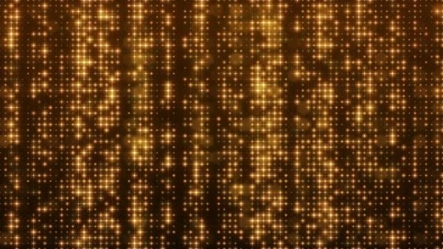 グリッターライト4k非常に詳細な背景ループ可能 - 金メダル点の映像素材/bロール
