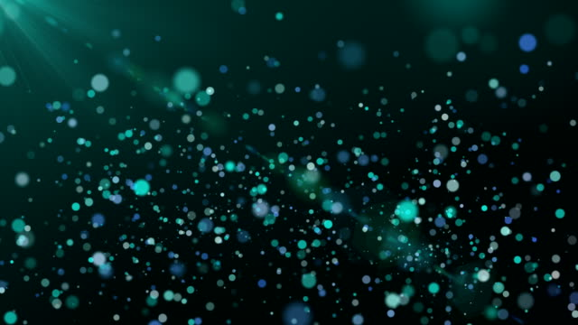 glitter particles on dark background, teal color theme - teal stock videos & royalty-free footage