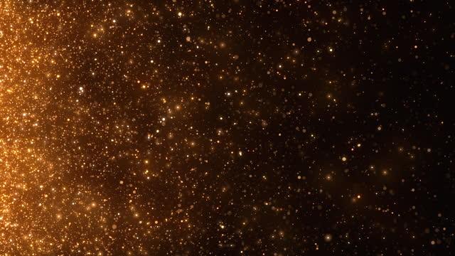 スローモーションで輝く金の粒子 - グラマー、クリスマス、お祝い、横向き - 抽象的な背景アニメーション - ループ可能 - 金メダル点の映像素材/bロール