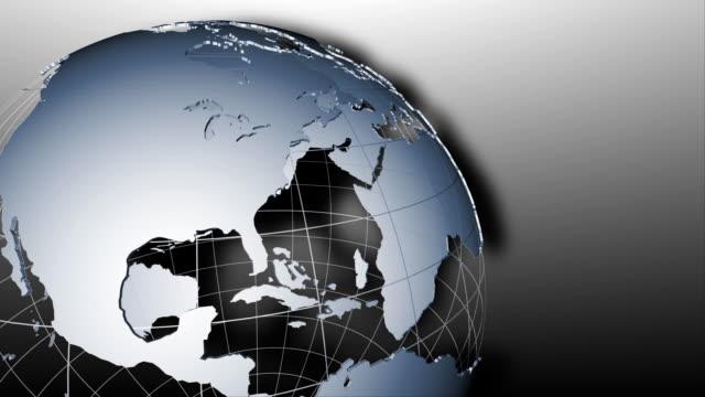 global 0808: an earth globe rotates on a gray background - 地形点の映像素材/bロール