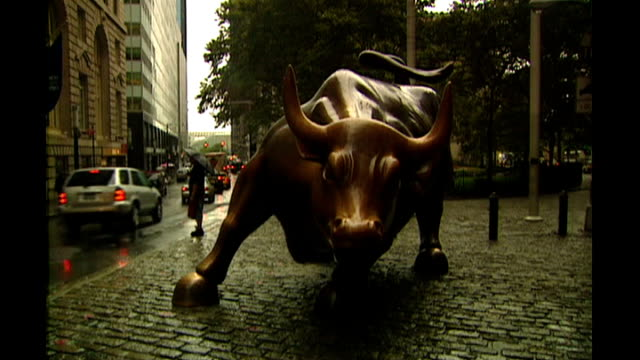 global banking crisis: rescue plan yet to be decided; shots of 'charging bull' bronze sculpture bus with 'wall street' destination sign traffic... - banking sign stock videos & royalty-free footage