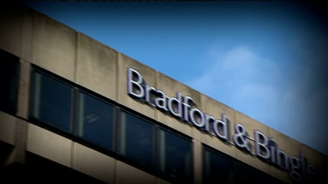 ft one hundred index drops to lowest level in three years england yorkshire bingley headquarters of bradford and bingley bank / branch david matthews... - credit union stock videos & royalty-free footage