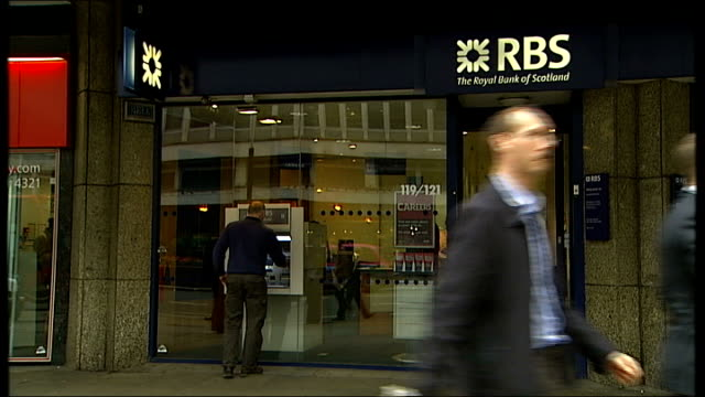 government buys into high street banks rbs hbos lloyds good shots bank advertisement 'your finances sorted' people along past entrance to branch of... - man and machine stock videos & royalty-free footage
