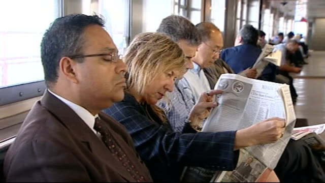 stockvideo's en b-roll-footage met senate prepares to vote on financial bailout bill for sale sign on house passengers sitting inside ferry boat ext staten island ferry along in water... - for sale korte frase