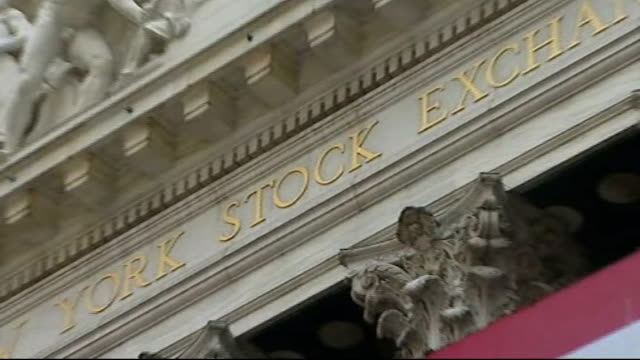Stocks rally as hopes continue for financial bailout USA New York Wall Street EXT New Yorkers walking past the New York Stock Exchange building and...