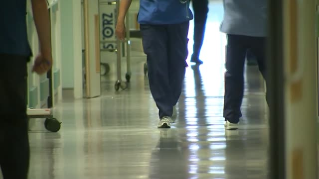 global cyber attack cripples nhs computer systems; r04101613 lancashire: blackburn: int anonymous shots of nurses in hospital corridor - nhs stock videos & royalty-free footage