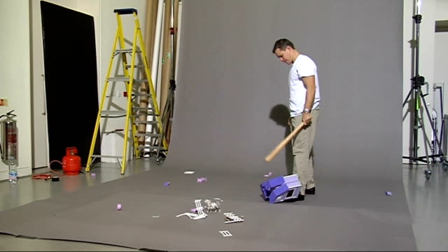 Global day of protest calling for an end to violence in Darfur LIB Matt Damon smashing up dolls house with baseball bat as part of a new campaign to...