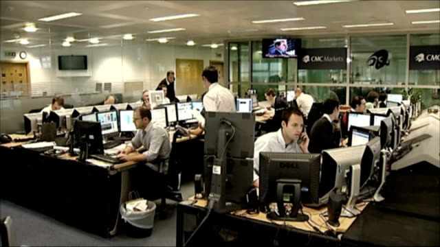 global financial crisis: stock market crash; england: london: int traders at seated at computer screens in cmc trading room - crisis stock videos & royalty-free footage