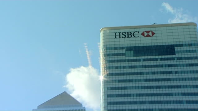 worldwide stock markets plunge Canary Wharf General views HSBC headquarter offices and other office skyscraper buildings on sunny day HSBC sign at...