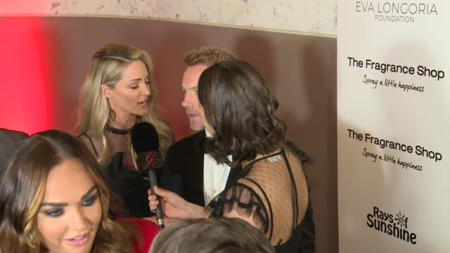 global gift gala 2018 red carpet arrivals; england: london: ext / int mel c red carpet photocall / ronan keating and his wife storm keating talking... - ronan keating stock videos & royalty-free footage