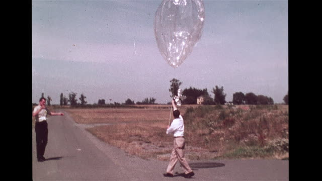global horizontal sounding technique program ms scientist releasing longrange superpressure weather balloon into air cu researchers looking up... - 1968 stock videos & royalty-free footage
