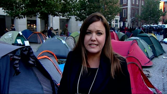 global protests against austerity cuts and corporate greed day tents belonging to protesters outside st paul's low angle view protest camp reporter... - corporate business stock videos & royalty-free footage
