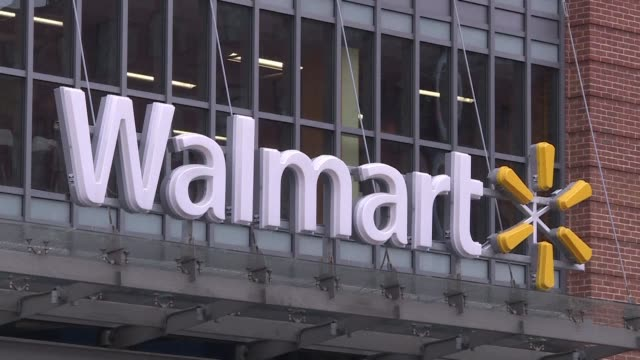 stockvideo's en b-roll-footage met global retail giant walmart raises its earnings estimate for the year after posting a strong quarter with sales growth across all its business lines - wal mart