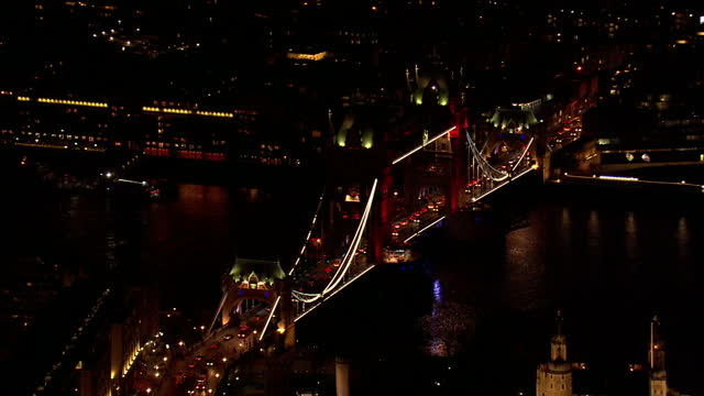 Global Support As Belgium Mourns Victims of Twin Terror Attacks Showing Aerial night shots Tower Bridge lit up in Belgian flag colours on March 23...