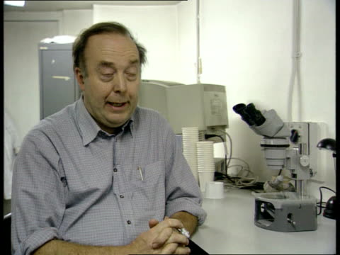 global warming increasing professor chris curtis working at netted enclosure which he uses to study mosquitoes curtis cs glass tube containing... - microscopic animal stock videos and b-roll footage