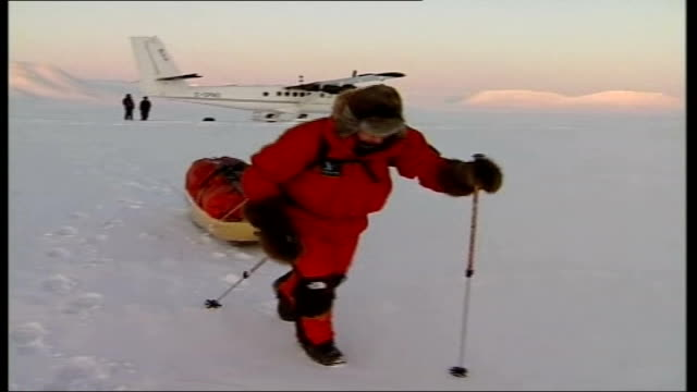 Canadian Arctic CANADIAN ARCTIC Polar ice caps AIR VIEW Ice caps with aircraft propellor in foreground INT AIRCRAFT Jim McNeill as looking out of...
