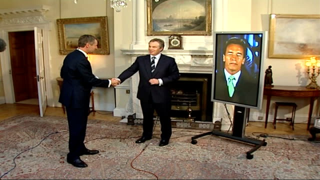 global warming/ uk signs up to climate change targets austin ending interview and blair thanking schwarzenegger for taking part sot - arnold schwarzenegger stock-videos und b-roll-filmmaterial