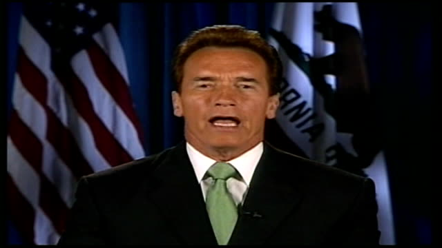 global warming/ uk signs up to climate change targets schwarzenegger interview sot one of my hummers has been turned into a hydrogen hummer and that... - hummer stock-videos und b-roll-filmmaterial