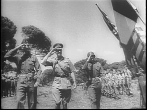 globe highlights allied attacks / allies mobilize equipment on secured beachhead in france / in italy, 5th and 8th armies of general harold alexander... - 1944 stock-videos und b-roll-filmmaterial