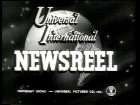 a globe spins in the introduction of the universal international newsreel. - ニュース映画点の映像素材/bロール