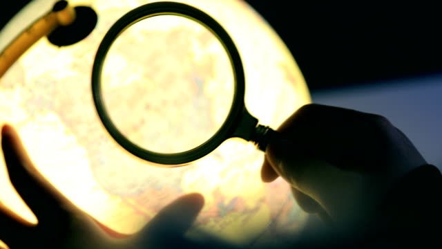 globe with magnifying glass - discovery stock videos & royalty-free footage