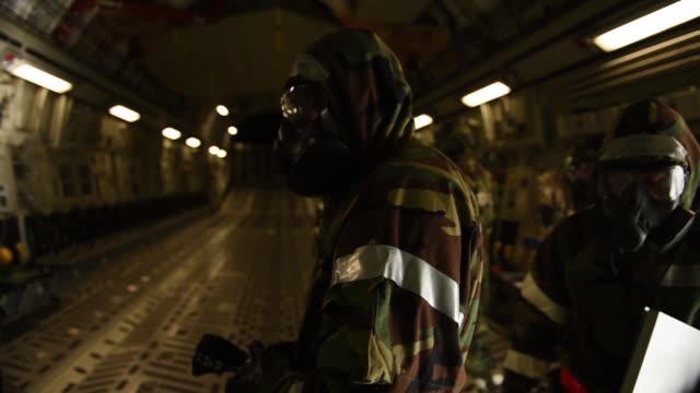globemaster iii aircrew dons mission oriented protective posture gear at travis air force base, calif., jan 31, 2018. the airmen were participating... - gas mask stock videos & royalty-free footage