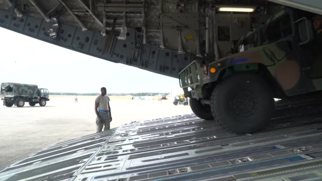 Globemaster III arrives at Naval Air Station Cecil Field Jacksonville Florida as part of Exercise Patriot Sands Soldiers offload vehicles from the...