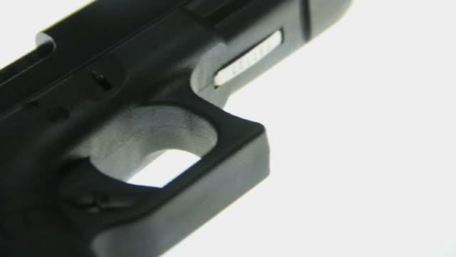 ecu pan glock 22c semi automatic pistol on light table / los angeles, california, usa - pistol stock videos and b-roll footage