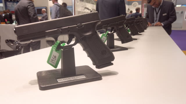 glock 31 gen 4 calibre 357 handgun is seen on day one of the dsei arms fair at excel on september 10 2019 in london england held every two years in... - camouflage stock videos & royalty-free footage