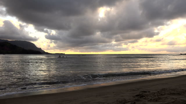 gloomy sunset just off of kauai island - butte rocky outcrop stock videos & royalty-free footage