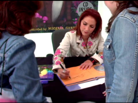 gloria estefan and fans at the book signing of gloria estefan's new children's book at toys r us times square in new york new york on october 12 2005 - toys r us stock videos and b-roll footage
